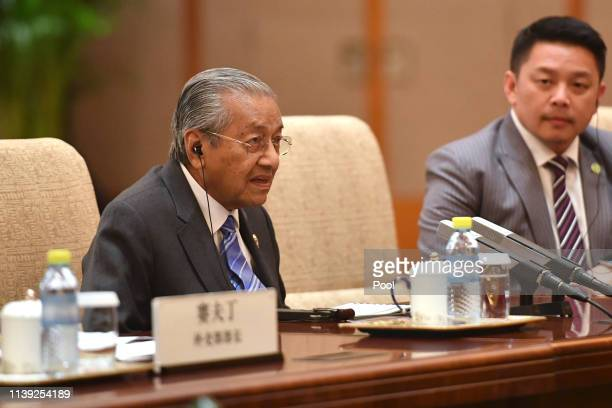 Malaysia's Prime Minister Mahathir Mohamad talks to Chinese Premier Li Keqiang, not pictured, during their meeting at the Diaoyutai State Guesthouse...