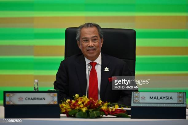 Malaysia's Prime Minister Muhyiddin Yassin takes part in the online Asia-Pacific Economic Cooperation leaders' summit in Kuala Lumpur on November 20,...