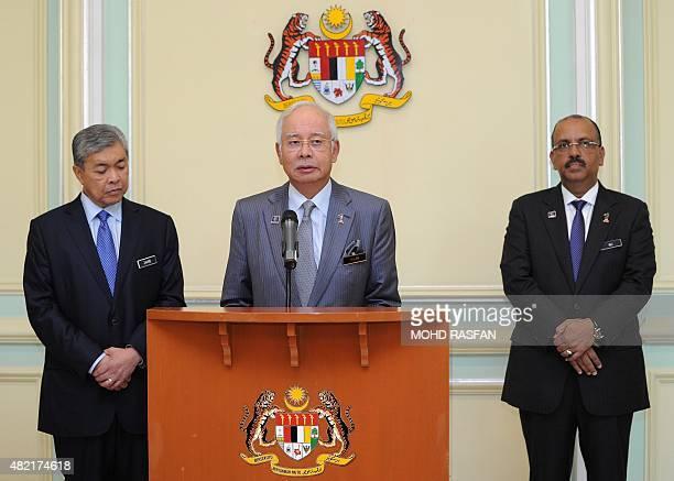 Malaysia's Prime Minister Najib Razak addresses a press conference as newlyappointed Deputy Prime Minister Ahmad Zahid Hamidi and Malaysia's Chief...
