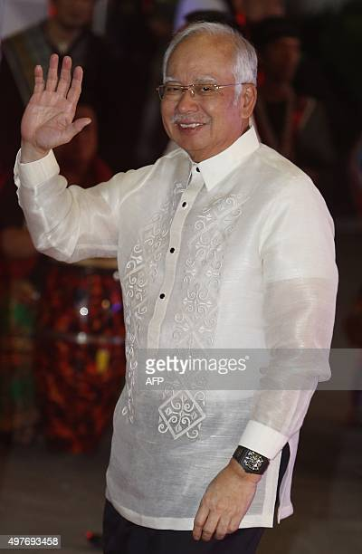 Malaysia's Prime Minister Najib Razak arrives for a welcome dinner during the Asia-Pacific Economic Cooperation summit in the capital city of Manila...