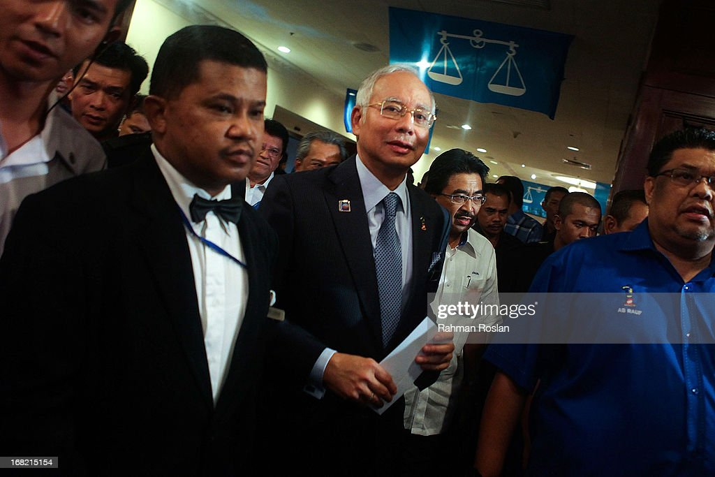 Malaysia's Prime Minister, Najib Razak arrives for the first meeting with his newly elected Barisan Nasional's (BN) parlimentary and state representative at Putra World Trade Centre on May 7, 2013 in Kuala Lumpur, Malaysia. Despite winning the election, Najib put the the blames on chinese voters for BN's failure to gain a majority of the popular vote Ð the first time in 44 years.