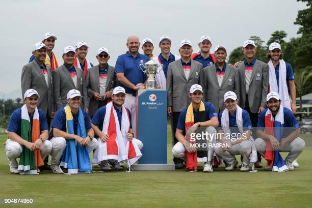 Malaysia's Prime Minister Najib Razak poses for pictures with team Europe after winning the Eurasia Cup golf tournament at the Glenmarie Golf and...