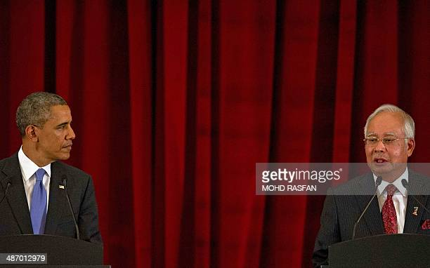 Malaysia's Prime Minister Najib Razak speaks as US President Barack Obama listens during a joint press conference at Seri Perdana in Malaysia's...