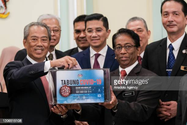 Malaysia's Prime Minister Tan Sri Muhyiddin Yassin launched the COVID19 relief fund after the first official Cabinet Meeting at the Prime Minister's...