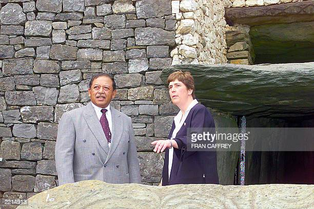 Malaysia's Royal Highness Yang diPertuan Agong King of Malaysia listens to Claire Tuffy manager of the Bru na Boinne centre as they visit New Grange...