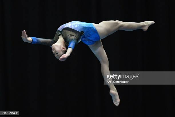 Malaysia's Tang Ing Yueh competes in the women's artistic gymnastic balance beam final event of the 29th Southeast Asian Games in Kuala Lumpur on...