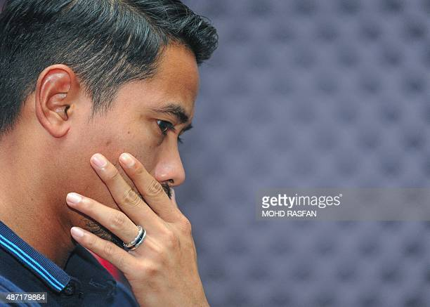 Malaysia's team captain Safiq Rahim gestures during a press conference at the Football Association of Malaysia headquaters in Kelana Jaya on the...