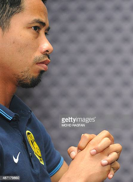 Malaysia's team captain Safiq Rahim listens to questions during a press conference at the Football Association of Malaysia headquaters in Kelana Jaya...