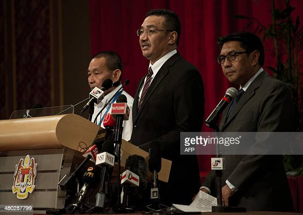 Malaysia's Transport Minister Hishammuddin Hussein answers questions during a press conference at the Putra World Trade Center in Kuala Lumpur on...
