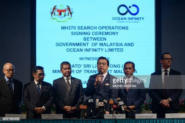 Malaysia's Transport Minister Liow Tiong Lai speaks during a press conference as Director general of Malaysia's Civil Aviation Department Azharuddin...