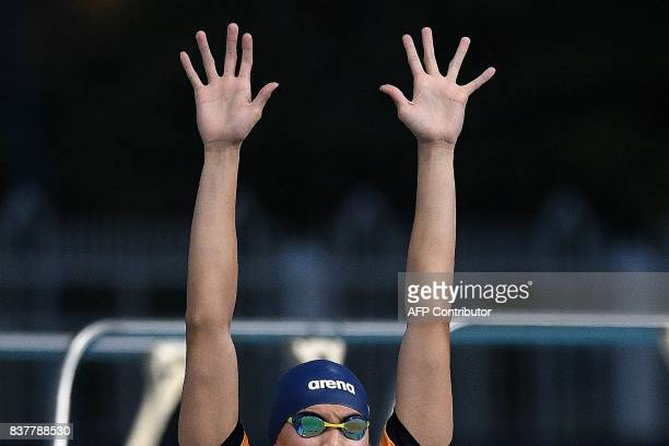 Malaysia's Welson Wee Sheng Sim stretches before the start of men's swimming 200m freestyle final event of the 29th Southeast Asian Games at the...