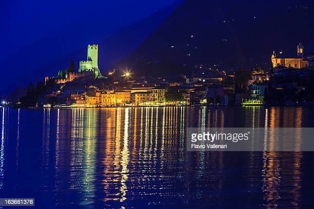 malcesine by night, lake garda - malcesine stock pictures, royalty-free photos & images