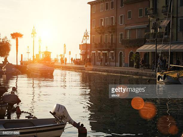 malcesine city harbor sunset on lake garda, northern italy - malcesine stock pictures, royalty-free photos & images