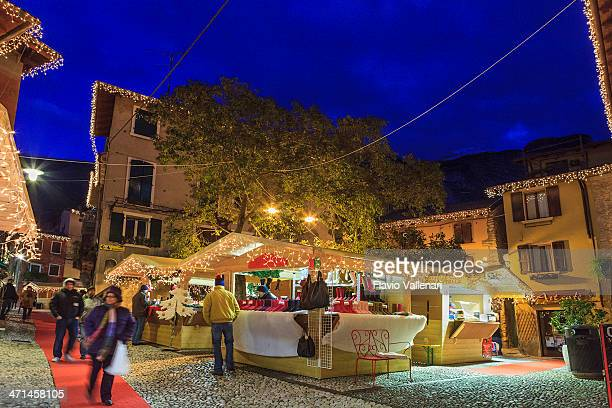 malcesine downtown at christmas, italy - malcesine stock pictures, royalty-free photos & images