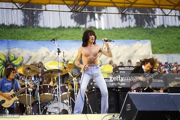 Malcholm Young, Bon Scott and Angus Young playing with 'AC/DC' performing at Oakland Coliseum in Oakland, California on July 21, 1979.