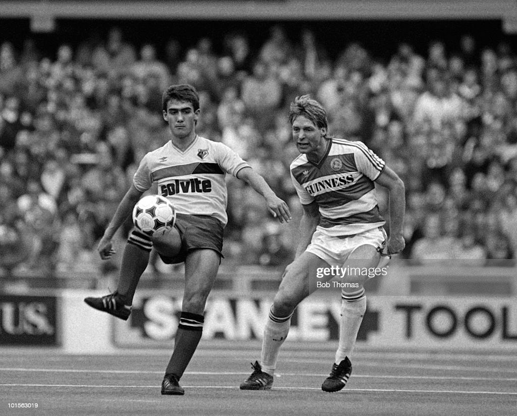 Malcolm Allen of Watford (left) is watched by Steve Wicks of Queens Park Rangers during the Division One match played on the astroturf at Loftus Road, London on 22nd March 1986. Queens Park Rangers beat Watford 2-1. (Bob Thomas/Getty Images).