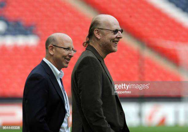 Malcolm and Avram Glazer, owners of Manchester United, watch during training ahead of the UEFA Champions League Final match between Manchester United...