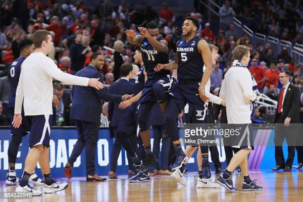 Malcolm Bernard and Trevon Bluiett of the Xavier Musketeers celebrate defeating the Maryland Terrapins 7665 in the first round of the 2017 NCAA Men's...
