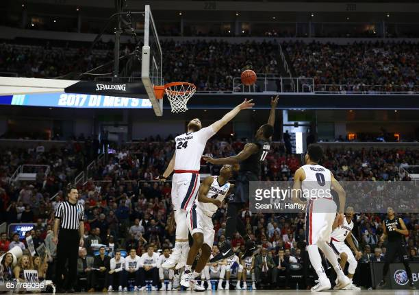 Malcolm Bernard of the Xavier Musketeers goes up against Przemek Karnowski of the Gonzaga Bulldogs in the first half during the 2017 NCAA Men's...
