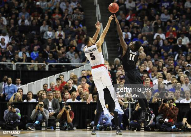 Malcolm Bernard of the Xavier Musketeers shoots against Nigel WilliamsGoss of the Gonzaga Bulldogs in the first half during the 2017 NCAA Men's...