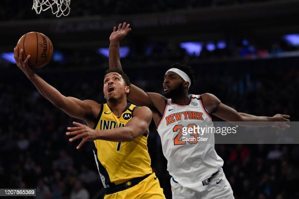 Malcolm Brogdon of the Indiana Pacers attempts a layup as Mitchell Robinson of the New York Knicks defends during the first half at Madison Square...