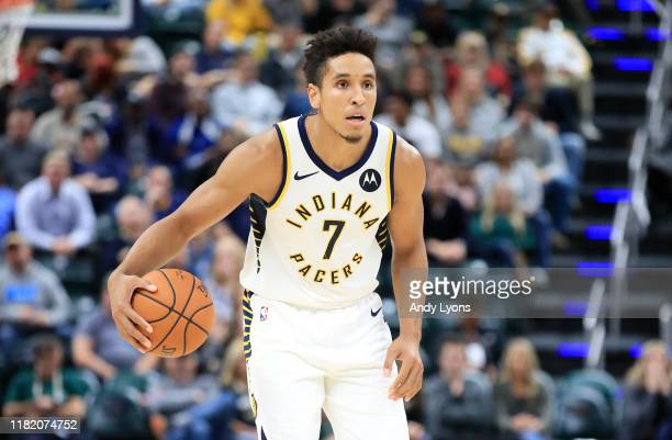 Malcolm Brogdon of the Indiana Pacers dribbles the ball against the Minnesota Timberwolves at Bankers Life Fieldhouse on October 15 2019 in...