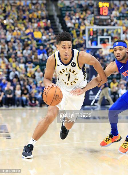 Malcolm Brogdon of the Indiana Pacers dribbles the ball against the Detroit Pistons at Bankers Life Fieldhouse on October 23, 2019 in Indianapolis,...