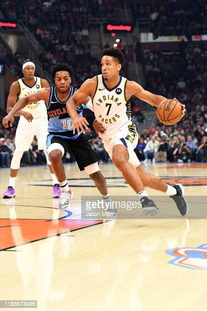 Malcolm Brogdon of the Indiana Pacers drives past Darius Garland of the Cleveland Cavaliers during the first half at Rocket Mortgage Fieldhouse on...