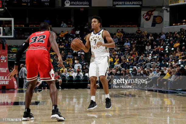 Malcolm Brogdon of the Indiana Pacers handles the ball against the Chicago Bulls during a preseason game on October 11 2019 at Bankers Life...
