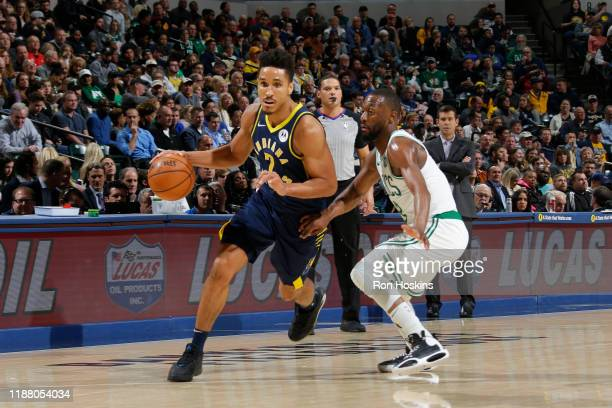 Malcolm Brogdon of the Indiana Pacers handles the ball against the Boston Celtics on December 11 2019 at Bankers Life Fieldhouse in Indianapolis...
