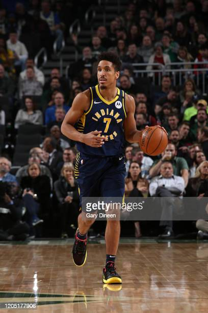 Malcolm Brogdon of the Indiana Pacers handles the ball against the Milwaukee Bucks on March 4 2020 at the Fiserv Forum Center in Milwaukee Wisconsin...