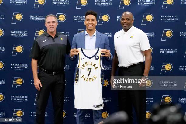 Malcolm Brogdon of the Indiana Pacers poses for a photo with Owner Kevin Pritchard and Head Coach Nate McMillan of the Indiana Pacers during a press...
