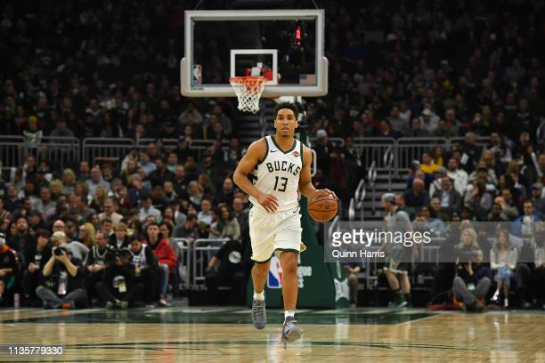 Malcolm Brogdon of the Milwaukee Bucks brings the ball up court against the Indiana Pacers at Fiserv Forum on March 07 2019 in Milwaukee Wisconsin...