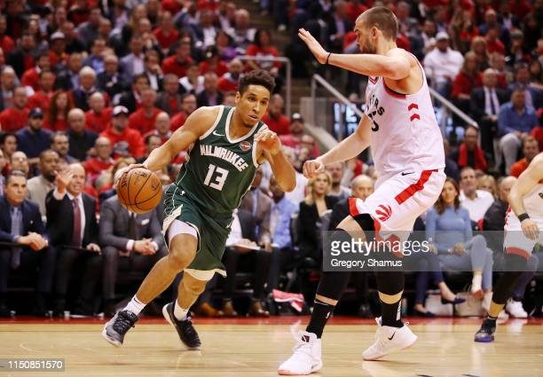 Malcolm Brogdon of the Milwaukee Bucks dribbles againts Marc Gasol of the Toronto Raptors during the first half in game four of the NBA Eastern...