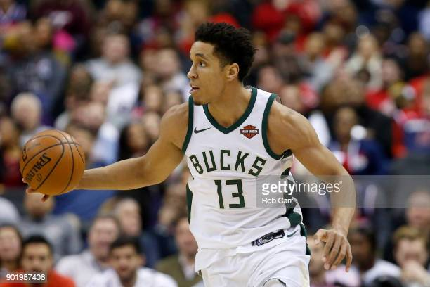 Malcolm Brogdon of the Milwaukee Bucks dribbles the ball against the Washington Wizards in the first half at Capital One Arena on January 6 2018 in...