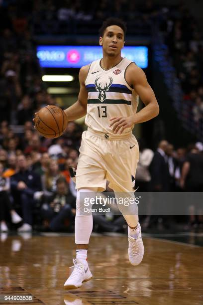 Malcolm Brogdon of the Milwaukee Bucks dribbles the ball in the first quarter against the Orlando Magic at the Bradley Center on April 9 2018 in...