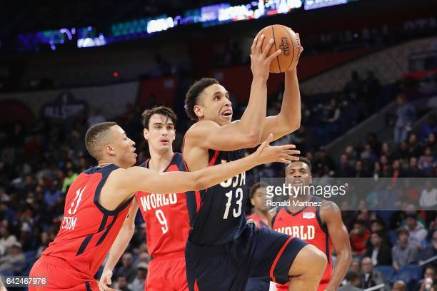 Malcolm Brogdon of the Milwaukee Bucks drives to the basket against Dante Exum of the Utah Jazz in the second half of the 2017 BBVA Compass Rising...