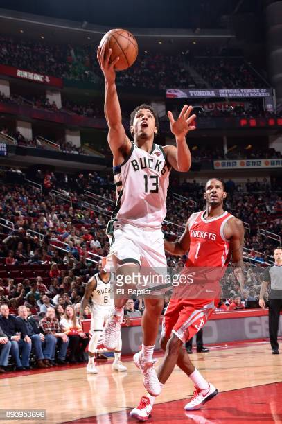 Malcolm Brogdon of the Milwaukee Bucks drives to the basket against the Houston Rockets on December 16 2017 at the Toyota Center in Houston Texas...