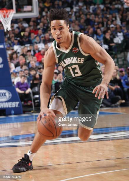 Malcolm Brogdon of the Milwaukee Bucks handles the ball against the Dallas Mavericks on February 8 2019 at the American Airlines Center in Dallas...