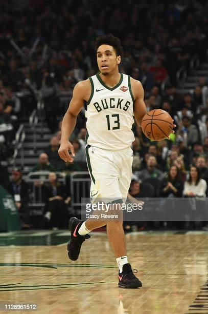 Malcolm Brogdon of the Milwaukee Bucks handles the ball during a game against the Orlando Magic at Fiserv Forum on February 09 2019 in Milwaukee...
