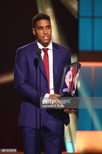 Malcolm Brogdon of the Milwaukee Bucks receives the Kia NBA Rookie of the Year at the NBA Awards Show on June 26 2017 at Basketball City at Pier 36...