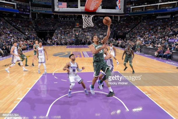Malcolm Brogdon of the Milwaukee Bucks shoots a layup against the Sacramento Kings on November 28 2017 at Golden 1 Center in Sacramento California...