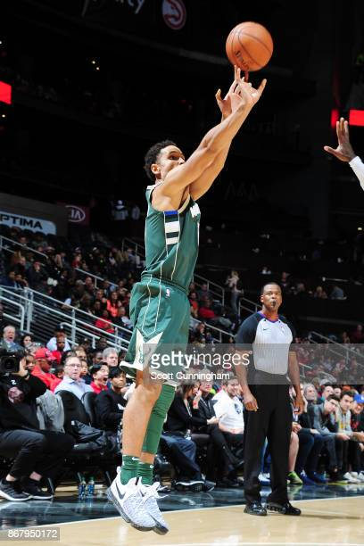 Malcolm Brogdon of the Milwaukee Bucks shoots the ball against the Atlanta Hawks on October 29 2017 at Philips Arena in Atlanta Georgia NOTE TO USER...