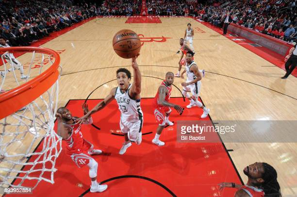 Malcolm Brogdon of the Milwaukee Bucks shoots the ball against the Houston Rockets on December 16 2017 at the Toyota Center in Houston Texas NOTE TO...