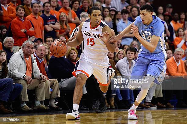 Malcolm Brogdon of the Virginia Cavaliers dribbles the ball against Justin Jackson of the North Carolina Tar Heels in the second half during their...