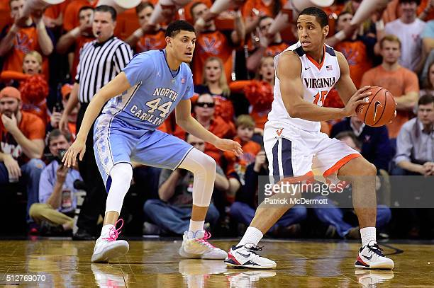 Malcolm Brogdon of the Virginia Cavaliers handles the ball against Justin Jackson of the North Carolina Tar Heels in the first half during their game...