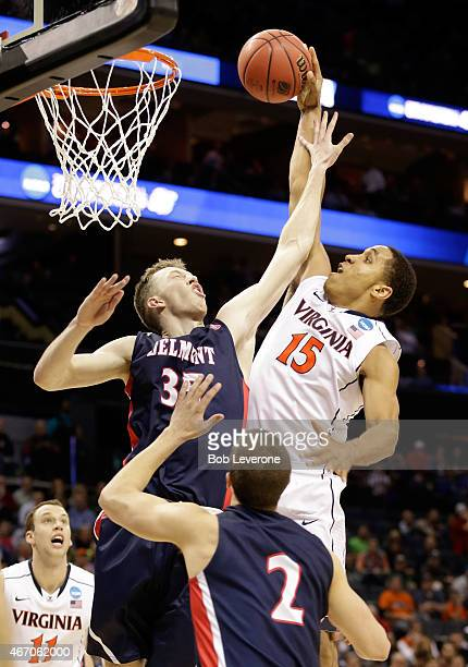 Malcolm Brogdon of the Virginia Cavaliers tries to dunk on Evan Bradds of the Belmont Bruins during the second round of the 2015 NCAA Men's...