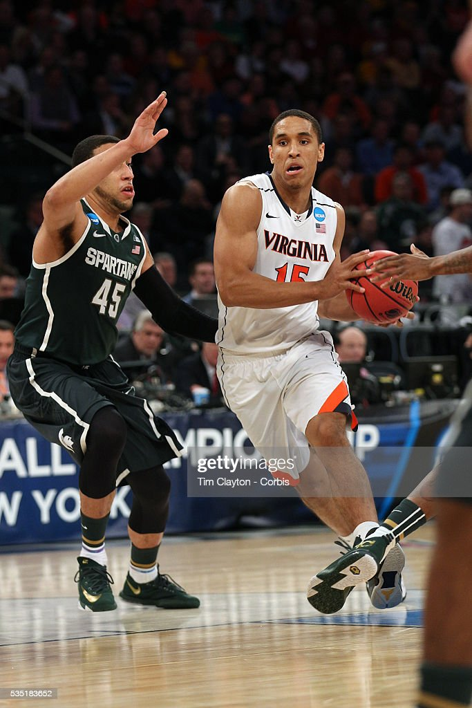 Malcolm Brogdon, Virginia, in action during the Virginia Cavaliers Vs Michigan State Spartans basketball game during the 2014 NCAA Division 1 Men's Basketball Championship, East Regional at Madison Square Garden, New York, USA. 28th March 2014. Photo Tim Clayton