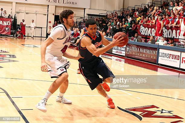 Malcolm Brooks of the Pepperdine Waves drives against Marin Mornar of the Loyola Marymount Lions in the first half of the game at Gersten Pavilion on...