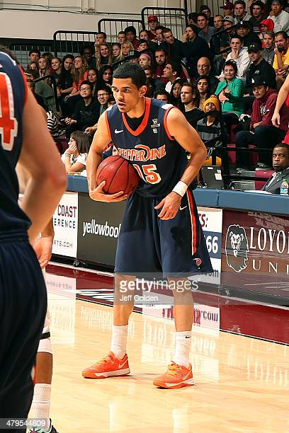 Malcolm Brooks of the Pepperdine Waves holds the ball against the Loyola Marymount Lions in the first half of the game at Gersten Pavilion on...